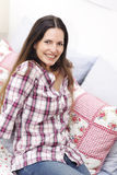 Attractive smiling woman relaxing stock photos