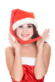 Attractive smiling woman in Santa Cap Royalty Free Stock Photography