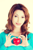 Attractive smiling woman showing red heart Royalty Free Stock Photo