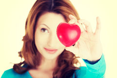 Attractive smiling woman showing red heart Royalty Free Stock Images