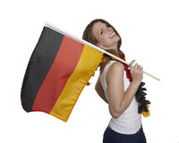 Attractive smiling woman shows german flag Stock Photos