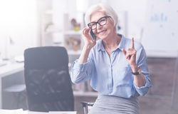 Attractive smiling woman speaking on the phone Stock Images