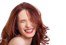 Attractive smiling woman squint eyes Royalty Free Stock Images