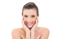 Attractive smiling woman touching her face Stock Photography