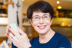 Attractive smiling woman using mobile phone Stock Photo