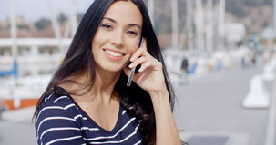 Attractive smiling woman using a mobile phone Royalty Free Stock Photo