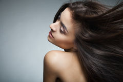 Attractive Smiling Woman With Long Hair On Grey Royalty Free Stock Photo