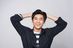 Attractive smiling young against gray background Royalty Free Stock Photo