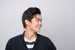 Attractive smiling young asian man Royalty Free Stock Images