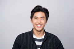 Attractive smiling young asian man Stock Images