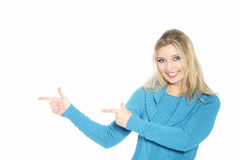 Woman pointing with both hands Royalty Free Stock Image