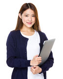 Attractive smiling young business woman holding laptop computer Royalty Free Stock Photos