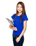 Attractive smiling young business woman holding laptop computer Stock Photo