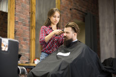 Attractive smiling young man in barbershop Royalty Free Stock Photo