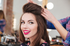 Attractive smiling young woman in beauty salon Stock Photography