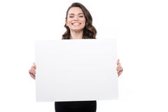 Attractive smiling young woman with blank banner. Isolated on white Royalty Free Stock Photo