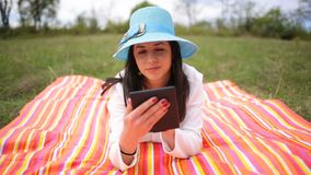 Attractive smiling young woman with e-book/tablet. Slide slider