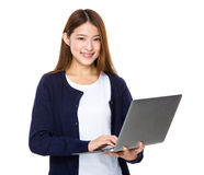Attractive smiling young woman holding laptop computer. Isolated on white background Stock Photography