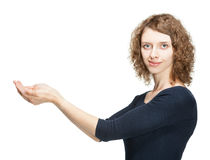 Attractive smiling young woman holding something in her hands Stock Photos
