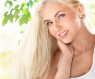 Attractive smiling young woman outdoors at sunny day Stock Photo