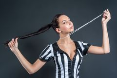 Attractive Soccer Referee holding whistle Stock Photography