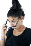 Attractive South Asian teen girl removing her big black glasses Stock Image
