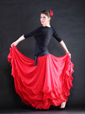 Attractive spanish young woman dancing flamenco over black backg Stock Image
