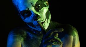 Attractive spooky girl with skeleton makeup stock photos