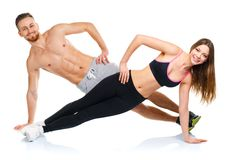 Attractive sport couple - man and woman doing fitness exercises Royalty Free Stock Photography