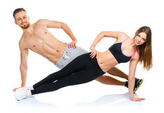 Attractive sport couple - man and woman doing fitness exercises Stock Photo