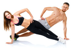 Attractive sport couple - man and woman doing fitness exercises Royalty Free Stock Images