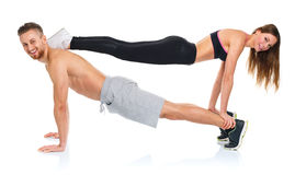 Attractive sport couple - man and woman doing fitness exercises Royalty Free Stock Photos