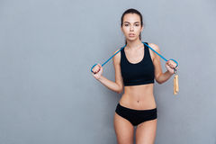 Attractive sport girl holding jumping rope and looking at camera Royalty Free Stock Image