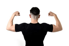 Attractive sport man wearing black t-shirt with  copy space for. Advertising corporate back portrait of young attractive sport man with big strong body wearing Royalty Free Stock Images