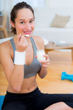 Attractive sportive woman eating yoghurt after sport Stock Photo