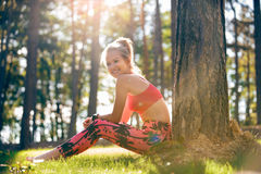 Attractive sportive woman wearing smart watch taking a break after workout session. Lifestyle image. With strong lensflare Royalty Free Stock Images