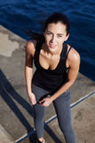 Attractive sports girl having a rest after run outdoors Stock Images