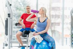 Fitness couple woman and man exercise workout in the gym royalty free stock images