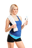Attractive sportswoman with a bottle of water Stock Photography