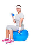 Attractive sportswoman doing exercise for biceps Stock Image