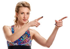Attractive sportswoman pointing Royalty Free Stock Photography