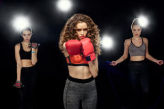 Attractive sportswomen boxing, training with dumbbells and jumping on a skipping rope Royalty Free Stock Images