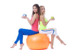 Attractive sportswomen sitting on gymnastic ball Stock Photography