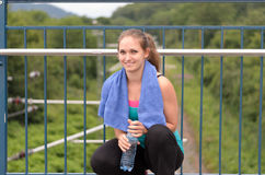 Attractive sporty girl holding bottled water Stock Photography