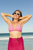 Attractive sporty mature woman ocean isolated Stock Photo