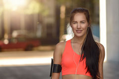 Attractive sporty young woman in town Royalty Free Stock Images