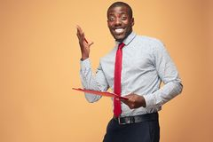 Attractive standing Afro-American businessman writing notes Royalty Free Stock Image