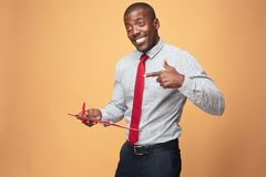 Attractive standing Afro-American businessman writing notes Royalty Free Stock Photography