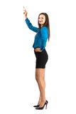 Attractive standing business woman pointing with pencil looking at camera Stock Photo