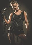 Attractive steampunk singer Royalty Free Stock Photography